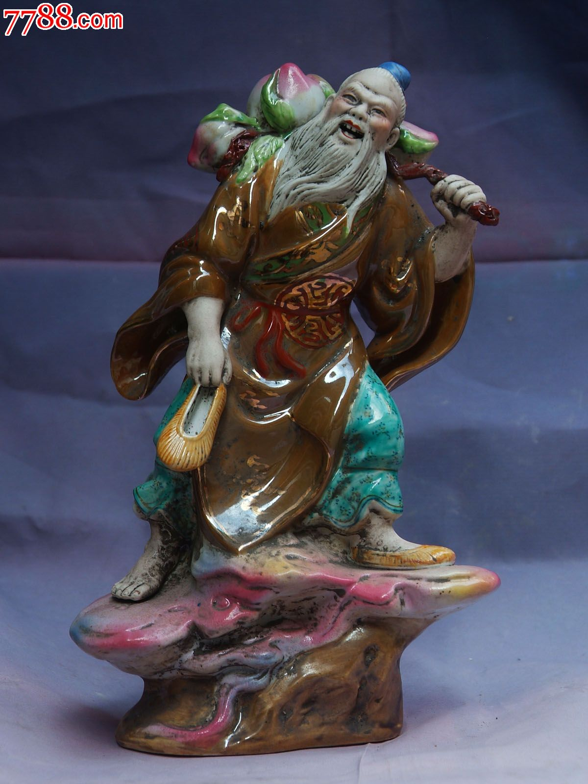 《东方朔偷桃》雕塑图片